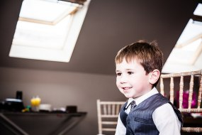 Cute boy in his finery at a wedding