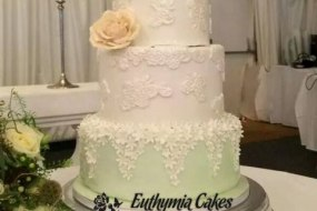 Bespoke Wedding cake with cut out lace and ivory sugar rose