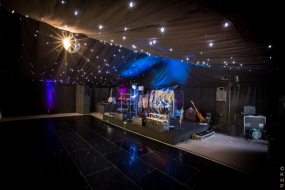 Starcloth ceilings, black dance floor, stage and glitter ball