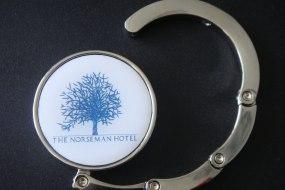 Custom design for hotel giveaways, round So-Hooked handbag hook with wraparound hanger