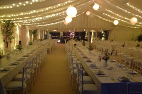 Straight tables, wedding marquee, fairy lighting