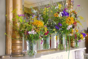 Seasonal summer blooms and wildflowers for a country house event