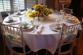 Dinner table laid with pretty vintage crockery