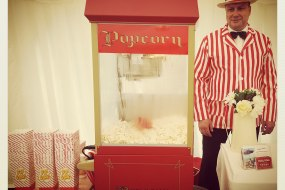 Chilly White Popcorn cart with uniformed server and unlimited helpings of fresh popcorn