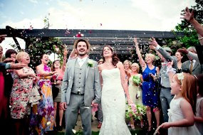 Natural rose petal wedding confetti being thrown