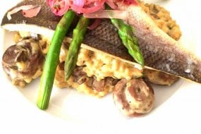 Seabass with mushroom and asparagus risotto