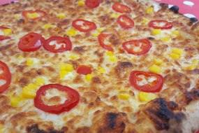 a chilli pepper and sweetcorn pizza