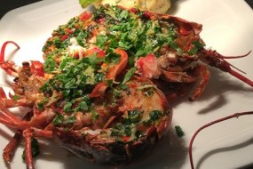 Grilled Lobster with Garlic and Herb Butter, Crushed Anya Potatoes and French Beans Wrapped in Pancetta
