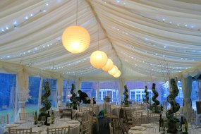 Fairy lights in the marquee roof lining along with chinese lanterns