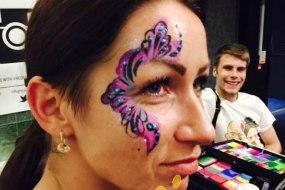 Purple swirl Glittery Eye Design by london face painter happy canvas