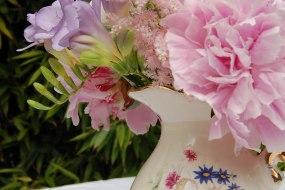Vintage jugs, teapots, cut glass vases, decorated jam jars and milk bottles for decorations.