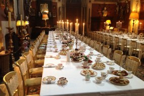 Beautiful formal afternoon tea with vintage china, table decorations and chair sashes.