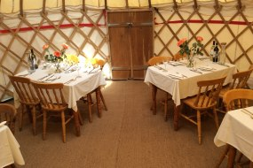 Yurt dining set up for 30 people