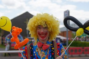 Cookie the Clown selling balloons