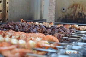 Prawns and kebabs cooking