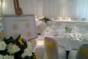 White Stretch Chair Covers + Sunflower Yellow Organza Sash