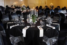 Black Stretch Chair Covers + Silver Organza Sash