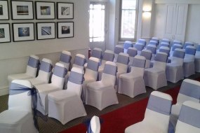 White Stretch Chair Covers + Navy Organza Sash