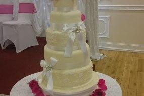 Ivory lace appliqué wedding cake