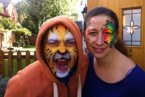 Donata's Face Painting - A tiger and a butterfly www.donatasfacepainting.co.uk