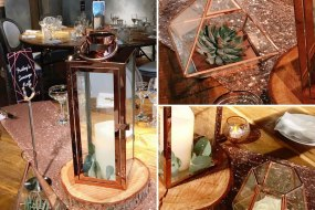 Rose gold lanterns and terrariums with sequin table runner