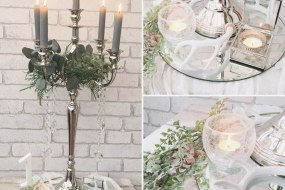 Silver candelabra on mirrored plate and gauze runner