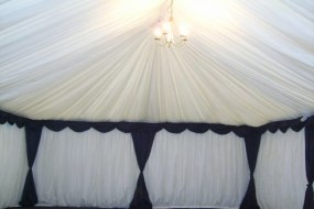 20ft Ivory linings with blue swags and drapes