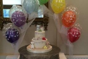 Rainbow cake table arch