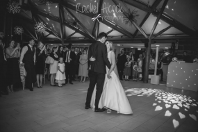 A beautiful first dance with hearts projected onto the floor
