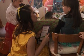 Princess Belle filling out each child's Well Done certificate