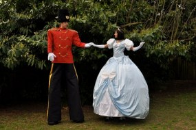Stilt walking Princess and Toy Soldier ready for the ball