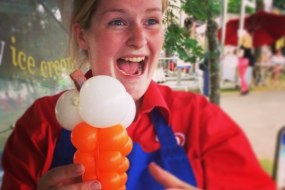 The Conwy Jester makes ice-cream seller smile with balloon ice-cream.