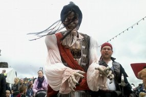 The Conwy Jester with 9 foot tall pirate puppet at pirate festival.