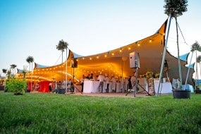Full stretch tent structures in summer action for a private celebration