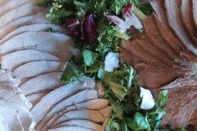 Sliced roast turkey breast and sirloin of beef