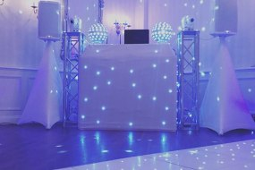 White DJ Booth and Lighting
