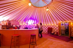 A large yurt with a round bar for drinking at.