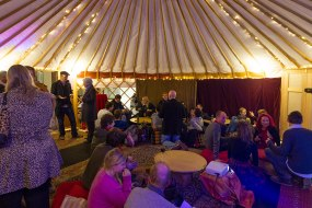 Our largest yurt. Decorated cosily. Groups of people enjoying the space.