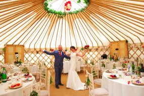 A newly married couple in the 8m yurt. Seats up to 50 people