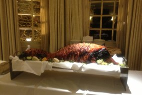 Whole roasted hog displayed on a table as a centre piece
