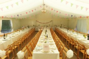 long tables with bunting