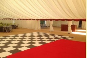 Large function for Hilton. Black and white dance floor. 15m wide marquee.
