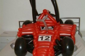 Clumsy Entertainment balloon sit in racing car