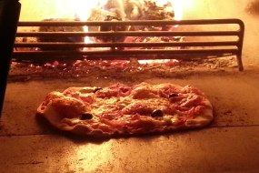 Mmm... hot, fresh pizza cooked in our wood-fired oven