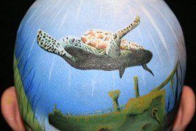 Body paint turtle swimming