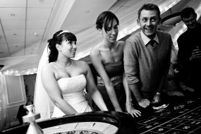 Wedding guests enjoying playing a game of roulette at one of our tables