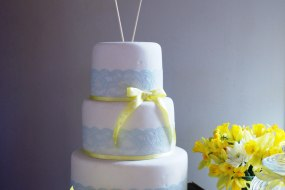 3 tier wedding cake with mint green and yellow lace decoration