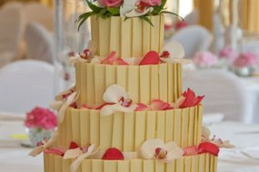 Tiered White chocolate panel cake with fresh flower decor.