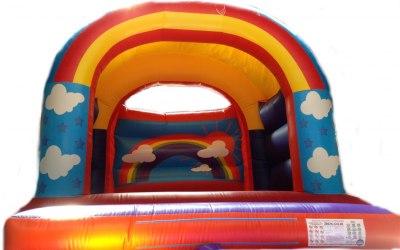 Rainbow bouncy castle - All ages