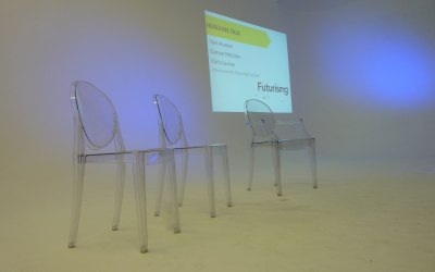 Minimal stage set - ghost chairs and projection in a studio presentation